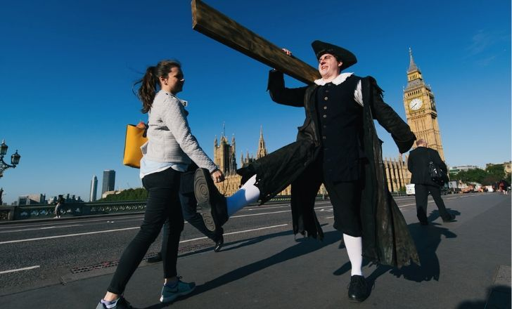 A man carrying a plank in the streets of London