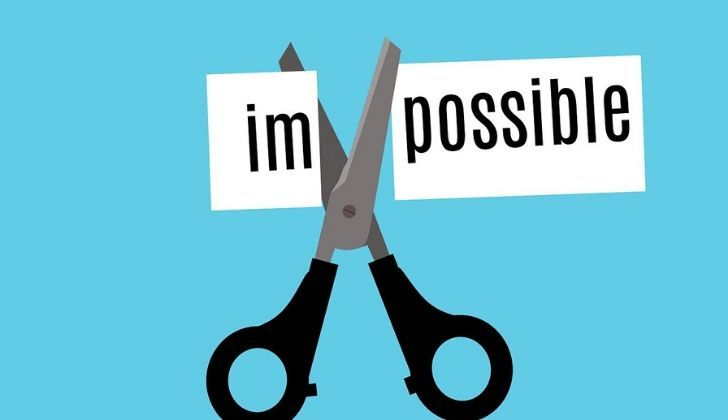 The word impossible split into 'im' and 'possible' with scissors