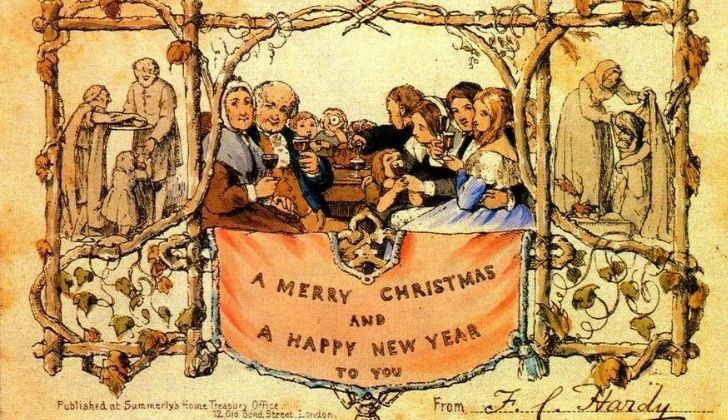 The first Christmas card with adults and children holding up a glass of wine while celebrating festivities