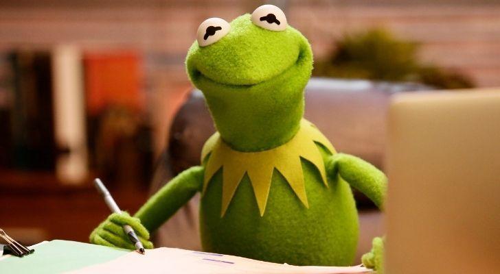 Kermit writing at a desk