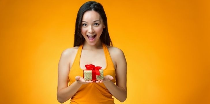 A Chinese woman happy to receive a gift