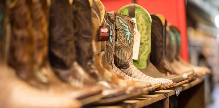 A row of different types of cowboy boots