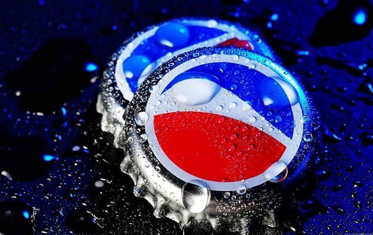 Two Pepsi bottle tops