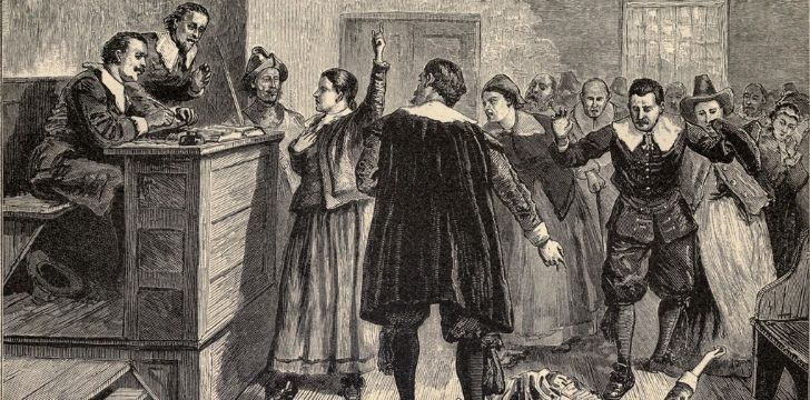 An illustration of a witch being trialed in court.