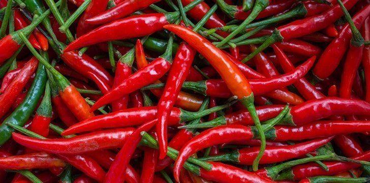 Sip a teaspoon of spicy sauce.