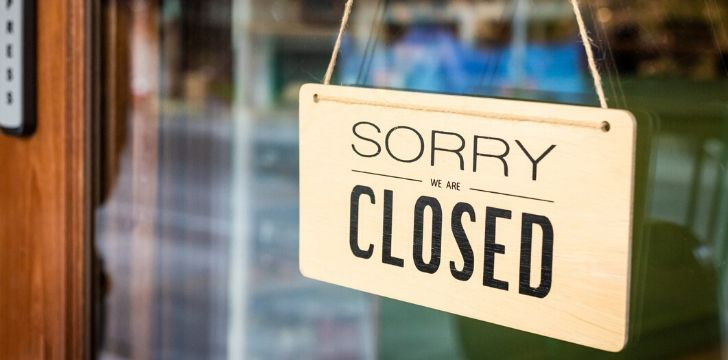A sign on a store door that says 'Sorry we are closed'.