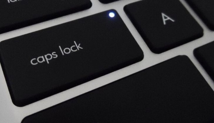 A picture zoomed into the caps lock key on a keyboard.