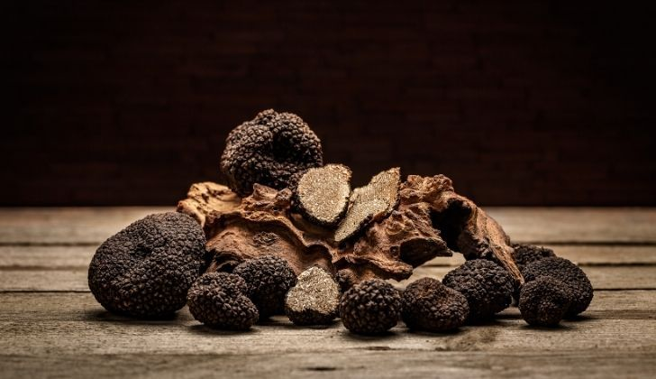 Several truffles on a wooden table