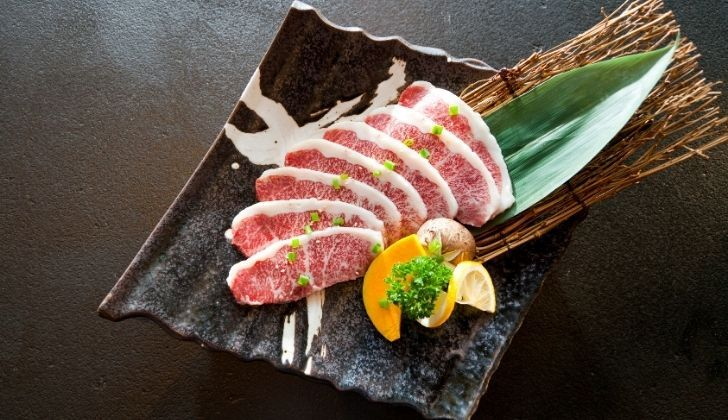 A plate of raw wagyu beef steaks
