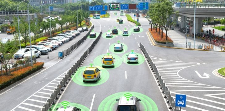 A picture of cars on a highway with green circles around them as a representation of them being driverless cars