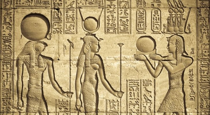 Egyptian art work showing ancient Egyptians carrying watermelons