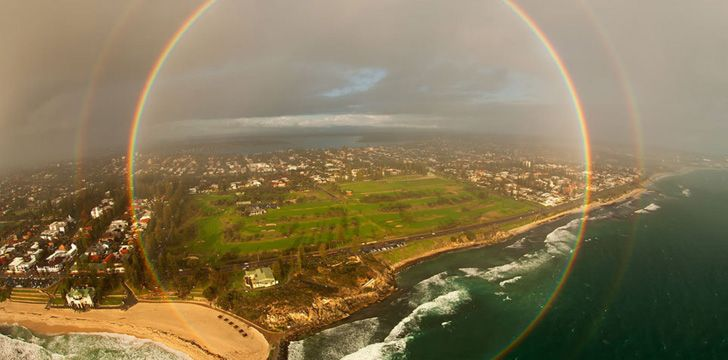 A round rainbow photo taken from a plane