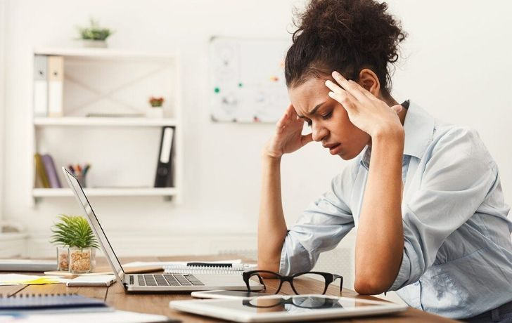 A woman looking stressed and weak