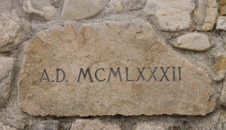 A stone plaque with Roman numerals