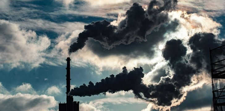 Greenhouse gasses coming out of factory chimney's