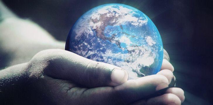 Earth being held in human hands