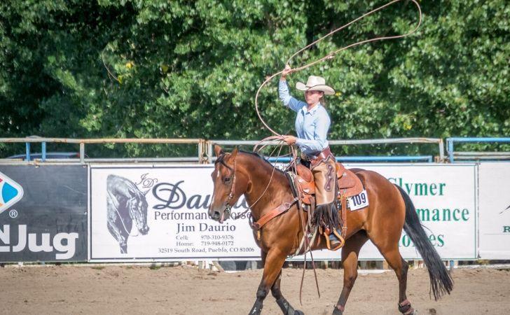 A woman riding a horse at rodeo fair in Colorado