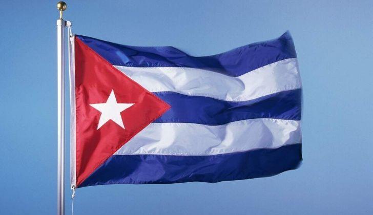 The Cuban flag flying on a pole.