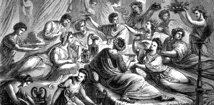 A group of Ancient Romans laying down at a banquet.