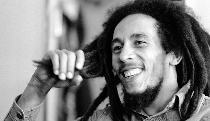 Greyscale portrait photo of singer Bob Marley.