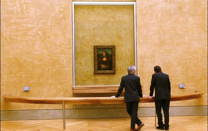 Two men looking at Mona Lisa