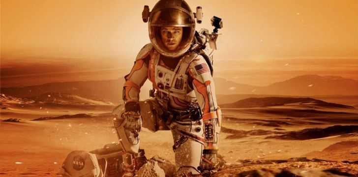 Matt Damon standing on the surface of Mars in the movie The Martian