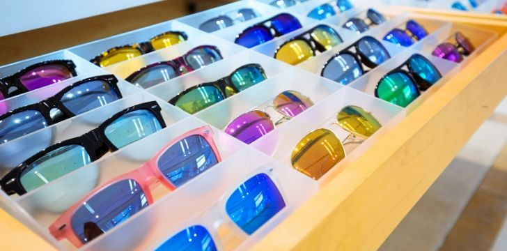 A tray of sunglasses in many colors