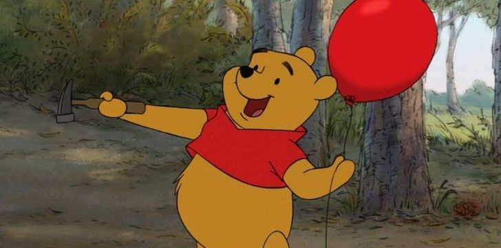 Winnie the Pooh holding a balloon