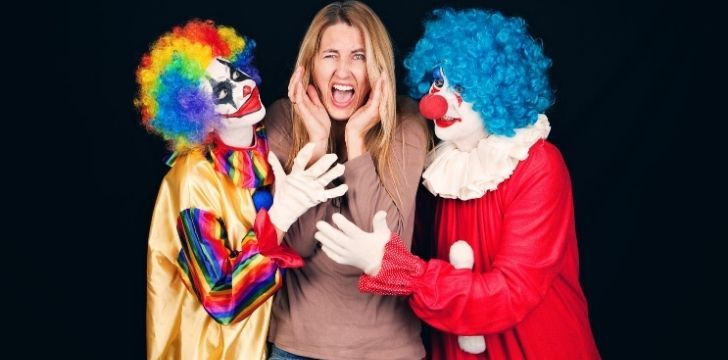A picture of a woman terrified of clowns