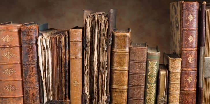 A row of many old books