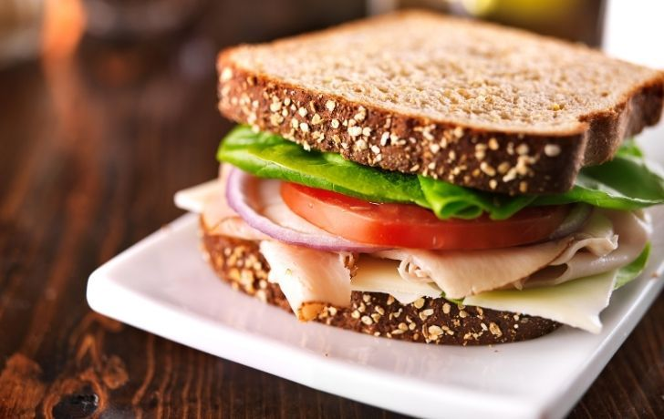 Delicious ham sandwich with lettuce and tomato