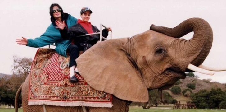 Michael Jackson riding an elephant