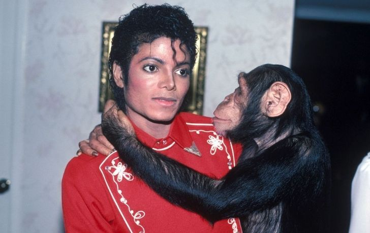 Michael Jackson with holding his pet chimp