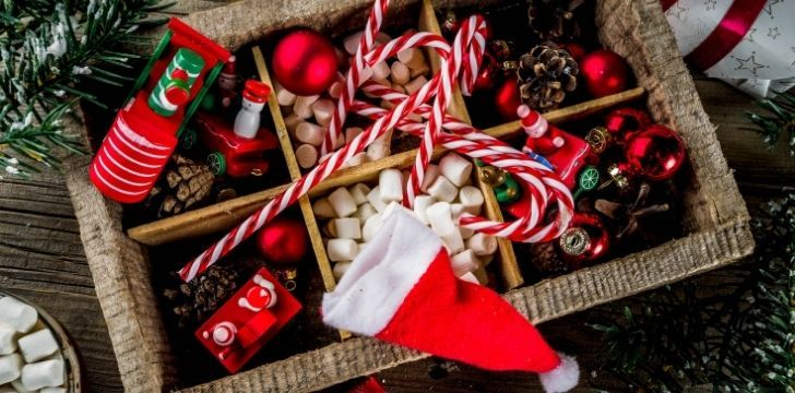 Traditional Christmas items like Christmas hat and candy canes and Christmas tree decorations