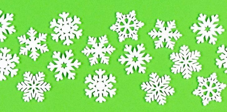 White snowflakes on a green background