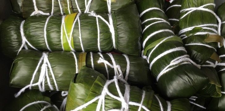 Beans wrapped in banana leaves