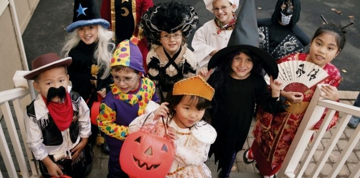 Children trick or treating expecting to be given candy