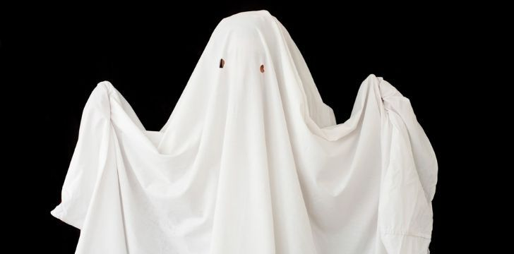A ghost made of a white bed sheet