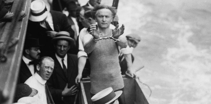 Harry Houdini handcuffed on a boat