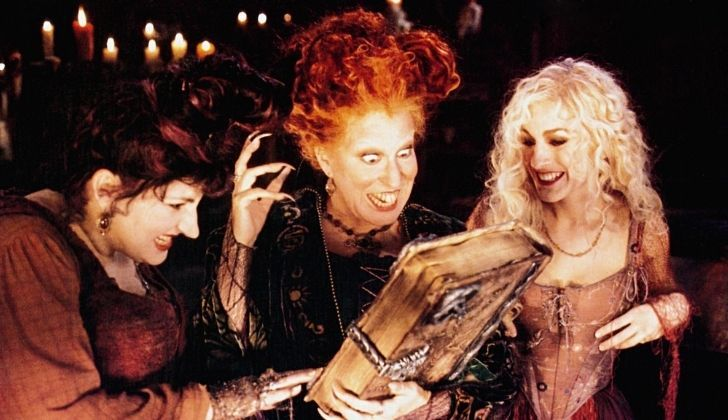 Hocus Pocus scene with three witches looking at the spell book