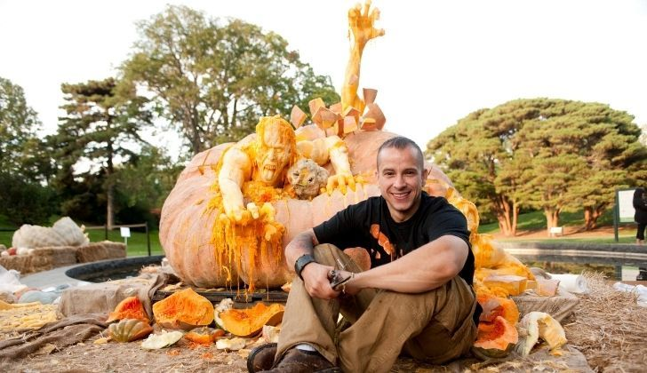 Ray Villafane with his apocalypse carved pumpkin behind him