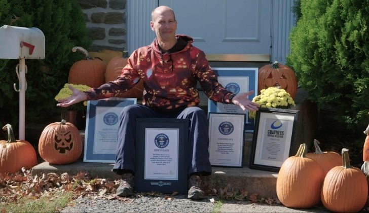 A picture of Stephen Clarke with many certificates