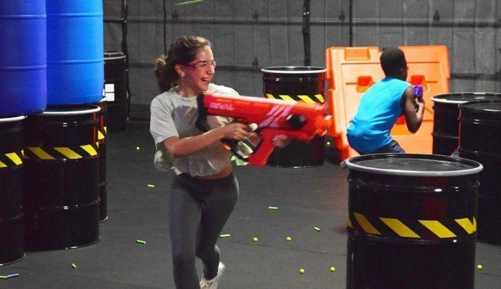 Children having a NERF gun fight