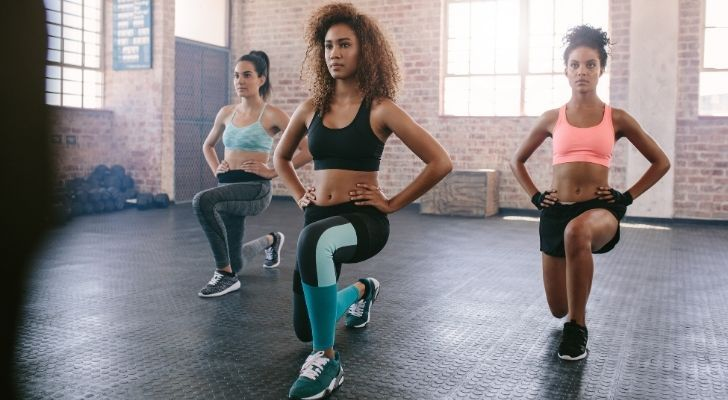 three woman performing lunges