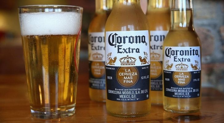 Corona beer bottles and a glass