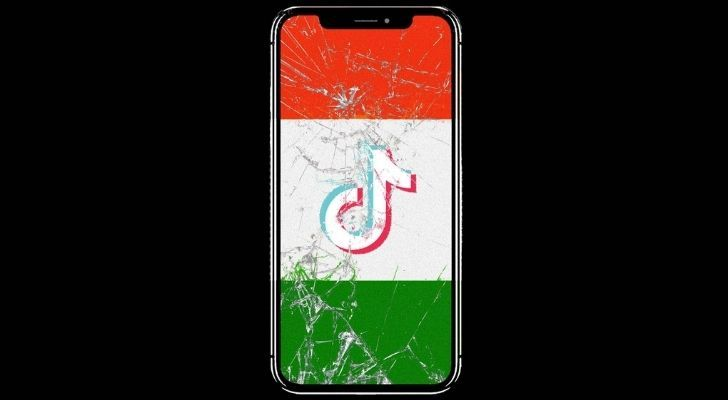 A smashed smart phone with India's flag on the screen and the Tik Tok logo in the middle