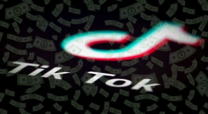 Tik Tok logo with lots of dollars floating over it