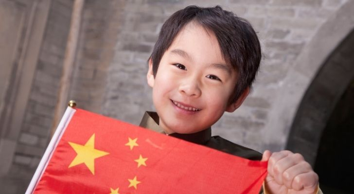 A Chinese boy holding a flag of China