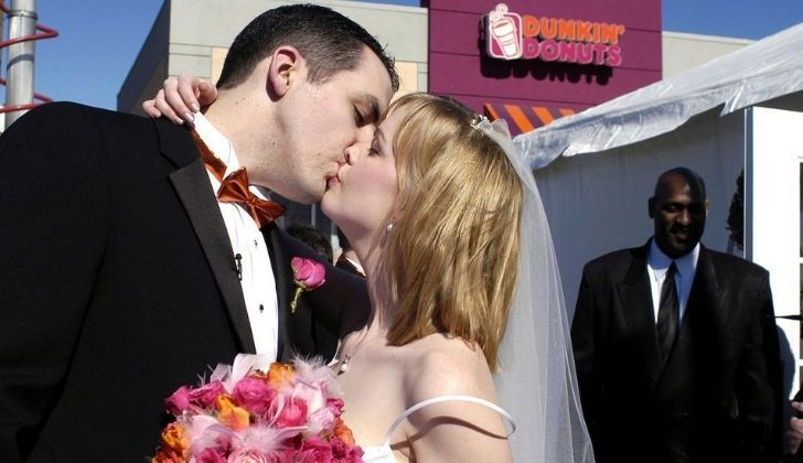 A couple getting married at Dunkin Donuts