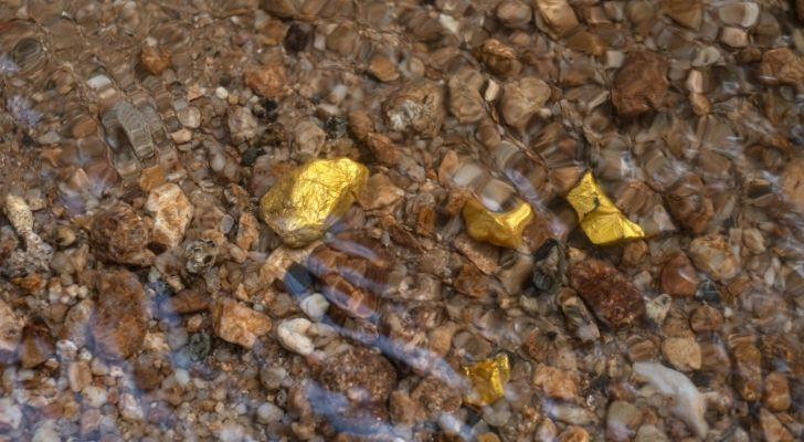Bits of raw gold stones in a stream